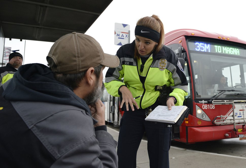 (Al Hartmann | Tribune file photo) UTA police officer Aymee Race explains the ticket she has just written up to a rider getting off a MAX bus who failed to buy a ticket.