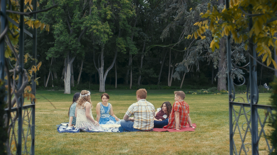 (Photo courtesy Pinnacle Peak Pictures) The March sisters — from left, Meg (Melanie Stone), Amy (Elise Jones), Beth (Allie Jennings) and Jo (Sarah Davenport) — enjoy a picnic with their friend Laurie (Lucas Grabeel, right) and his tutor Brooke (Stuart Edge), in a scene from director Clare Niederpruem's modern-day adaptation of Louisa May Alcott's Little Women.
