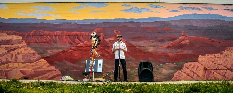 (Steve Griffin | The Salt Lake Tribune) Utah graphic artist Josh Scheuerman stands in front of his mural of landscapes from Bears Ears National Monument during a dedication ceremony on 800 South near 300 West in Salt Lake City on Friday, Nov. 24, 2017.