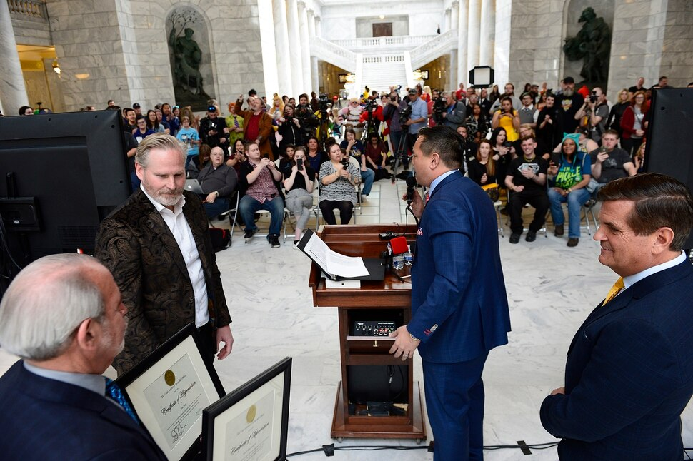 (Scott Sommerdorf | The Salt Lake Tribune) FanX Salt Lake Comic Convention co-founders Dan Farr, left, and Bryan Brandenburg are given commendations by Utah Attorney General Sean Reyes in the Utah Capitol Rotunda, Wednesday, April 11, 2018.