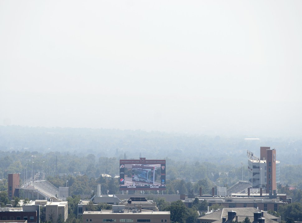 (Steve Griffin | The Salt Lake Tribune) Haze over Rice-Eccles Stadium in Salt Lake City Tuesday August 29, 2017. A group of Utah business is urging Gov. Gary Herbert and state lawmakers to take more aggressive action on air quality.