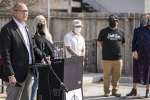 (Rick Egan | Tribune file photo) Mark Jenson, of Harmon's Grocery, speaks at a news conference along with Salt Lake City Mayor Erin Mendenhall, encouraging citizens to keep wearing masks, after the state mask mandate ends, Friday, March 19, 2021.