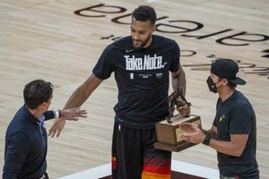 (Rick Egan   The Salt Lake Tribune) Utah Jazz center Rudy Gobert (27) receives the NBA's Defensive Player of the Year award for the third time in his career before Game 2 of the Westen COnference Semifinals against the LA Clippers at Vivint Arena, on Thursday, June 10, 2021.