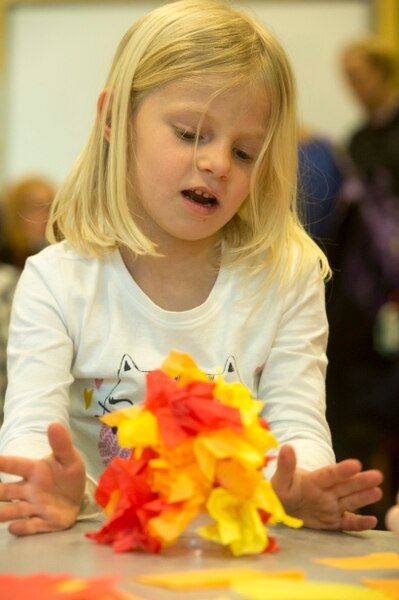 (Rick Egan | The Salt Lake Tribune) Lizzie Campbell, 5, works on crepe paper fire, at the Discovery Gateway, during their New Years Day celebration of cultural traditions from around the world including Romania, Iran, and Myanmar. In Iran they celebrate their new year buy building bon fires and jumping over them. Monday, January 1, 2018.