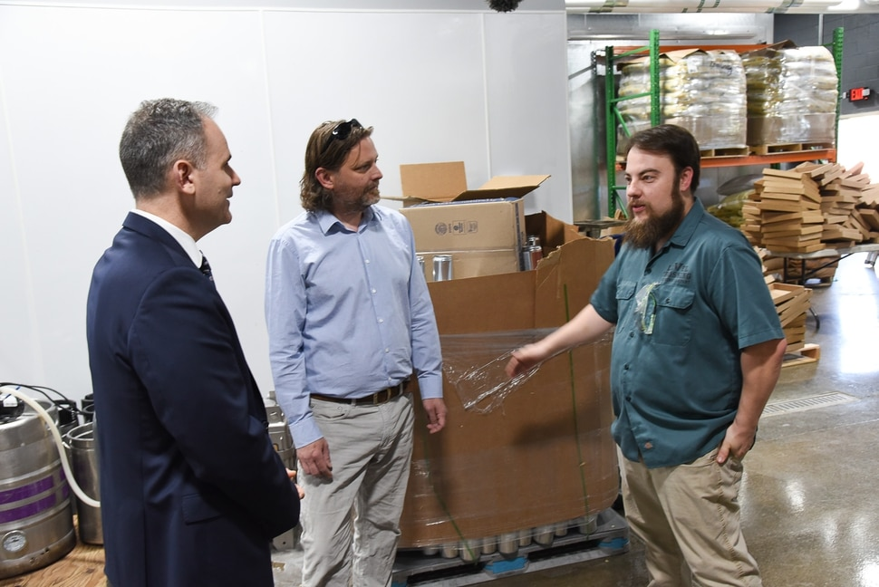 (Francisco Kjolseth | The Salt Lake Tribune) Christopher Pilkerton, left, acting head of the U.S. Small Business Administration and advocate for the nationÕs 30 million small businesses gets a tour of Level Crossing Brewing Company in South Salt Lake from owner Mark Medura, center, and head brewer Chris Detrick on Thursday, May 9, 2019. Pilkerton is visiting several small businesses in Utah to celebrate National Small Business Week.