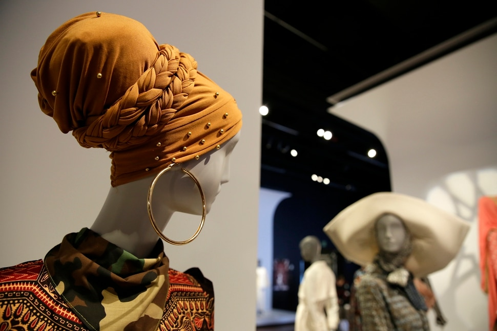 (Eric Risberg | AP Photo) In this photo taken Thursday, Sept. 20, 2018, a headscarf and wrap is displayed in the exhibit Contemporary Muslim Fashions at the M. H. de Young Memorial Museum in San Francisco. The first major museum exhibition of contemporary Muslim women's fashion reflects designs from around the world that are vibrant and elegant, playful and diverse. The show's creators hope the exhibit will show Muslim women as real people who can choose what they wear rather than as subjects ordered to cover their entire bodies or restricted in what they can wear. The exhibit opens on Saturday.