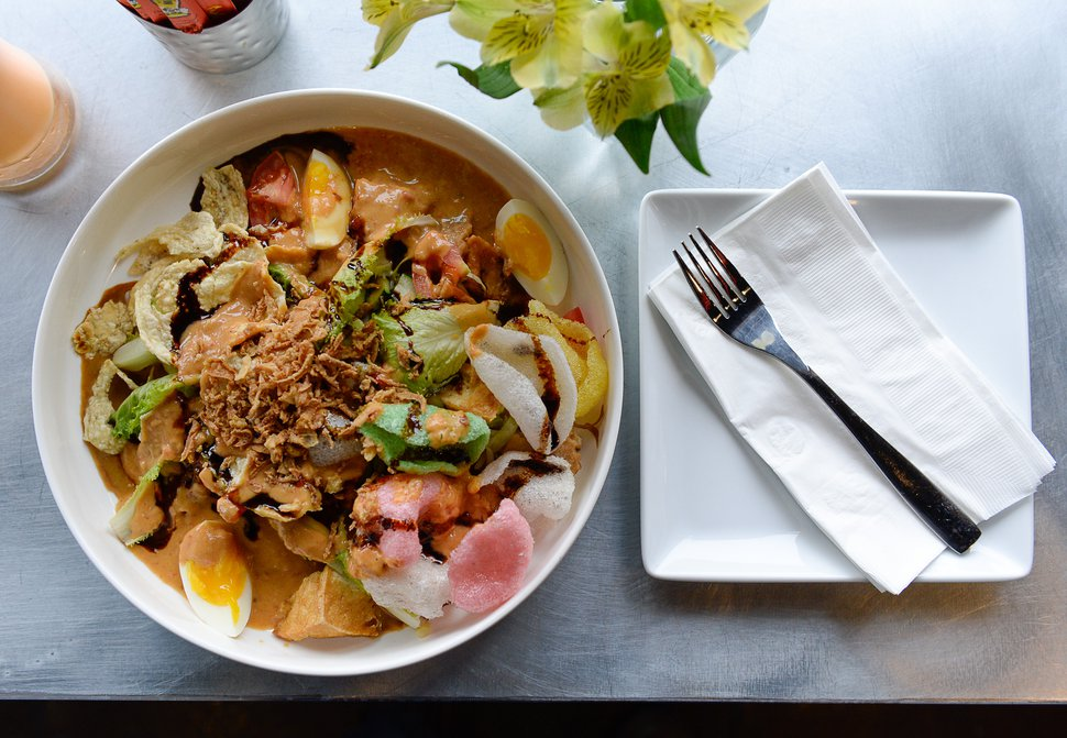 (Francisco Kjolseth | The Salt Lake Tribune) MakanMakan, a new restaurant in Sandy, offers Asian street food fare. Gado Gado — an Indonesian salad of blanched vegetables, hard-boiled egg, fried tofu, fried shallot, shrimp crackers and peanut sauce dressing — was one of the best dishes Tribune restaurant reviewers tried in 2018.