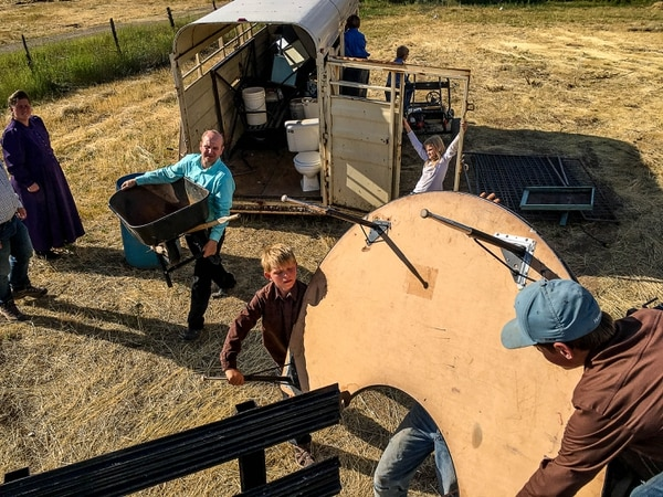 Trent Nelson   The Salt Lake Tribune Gabriel Owen, in green, helps load a truck and trailer for members of the FLDS polygamous sect living outside of Beaver, Saturday July 15, 2017. Owen and the Davis County Cooperative Society have been offering service and donations to needy FLDS members who were evicted from UEP homes in Hildale and Colorado City, Ariz.