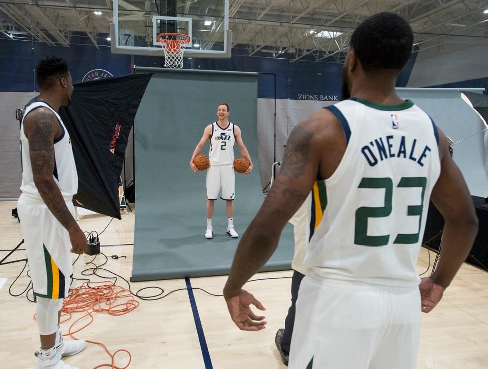 (Rick Egan | The Salt Lake Tribune) Utah Jazz center Tony Bradley, and Royce O'Neale, joke with Joe Ingles, as he poses for a photo, during the Utah Jazz media day, at the Zions Bank Basketball Center, Monday, September 25, 2017.