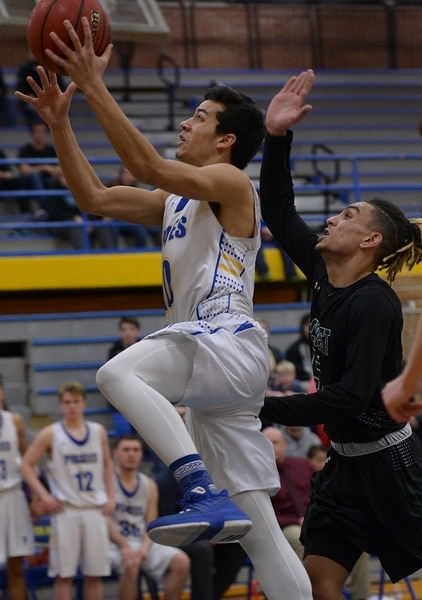 (Leah Hogsten | The Salt Lake Tribune) Cyprus' Josh Amasio hits the net. Cyprus High School boys' basketball team defeated Hillcrest High School 77-61 during their game Tuesday, January 30, 2018 in Magna.