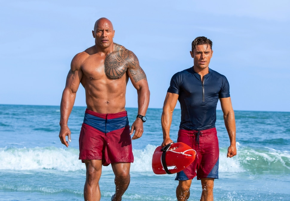 This image released by Paramount Pictures shows Dwayne Johnson as Mitch Buchannon, left, and Zac Efron as Matt Brody in