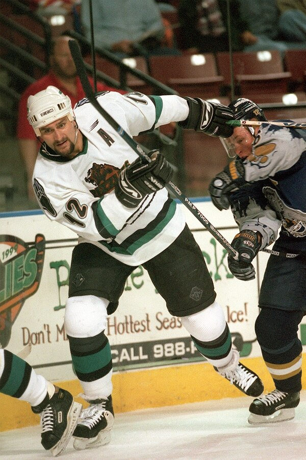 Trent Nelson   The Salt Lake Tribune Utah Grizzlies' #12 Mick Vukota in action vs. the Long Beach Ice Dogs, November, 1998.