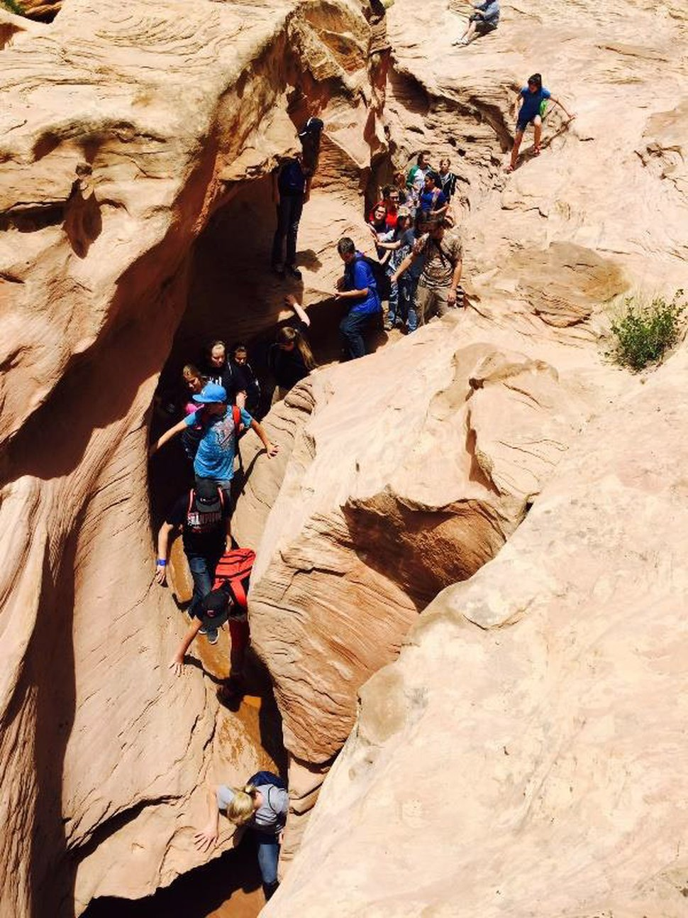(Photo courtesy of Bureau of Land Management) Hikers crowd the narrow slots of Little Wild Horse Canyon in the San Rafael Reef. BLM is developing a recreation management plan for the 200,000-acre Temple Mountain Area.