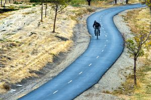 (Rick Egan     The Salt Lake Tribune)    A cyclist rides along the  Legacy Parkway Trail near Farmington. Utah now has nearly 1,000 mapped miles connecting cyclists to neighboring states.