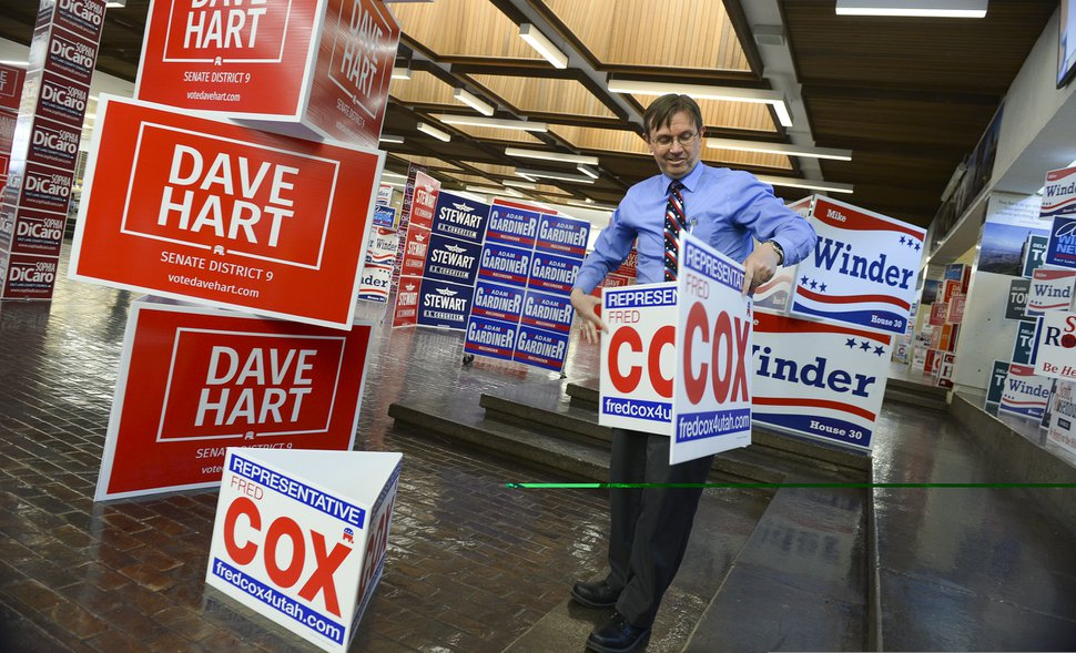 (Leah Hogsten | The Salt Lake Tribune) Utah House of Representatives District 30 candidate Fred Cox sets up his signs in the commons area at the Salt Lake County Republican Party Organizing Convention at Cottonwood High School, Saturday, April 14, 2018.