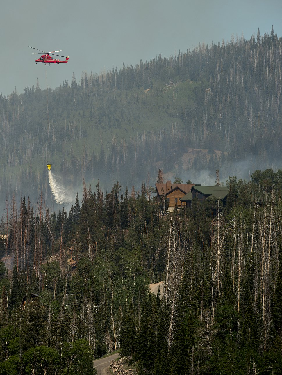Leah Hogsten | The Salt Lake Tribune Firefighting crews and air tankers work to put out a wildfire that forced hundreds to evacuate from the southern Utah ski town of Brian Head, Sunday, June 18, 2017. The slope driven fire, which is burning on private land, is zero percent contained.