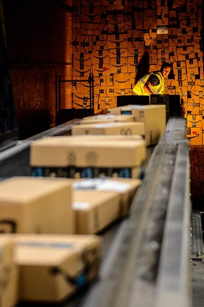 (Trent Nelson | The Salt Lake Tribune) A truck is loaded at Amazon's fulfillment center in Salt Lake City on Wednesday April 17, 2019.