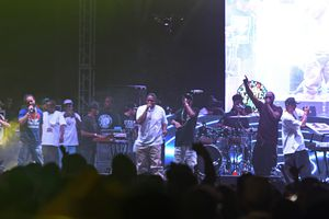 """In this Sunday, Sept. 25, 2016 photo, a drone approaches the stage as Bone Thugs-n-Harmony, perform during the High Life Music Festival at the High Desert Event Center in Victorville, Calif. Stanley """"Flesh-N-Bone"""" Howse, right, was struck by the drone while performing onstage.  (David Pardo/The Daily Press via AP)"""