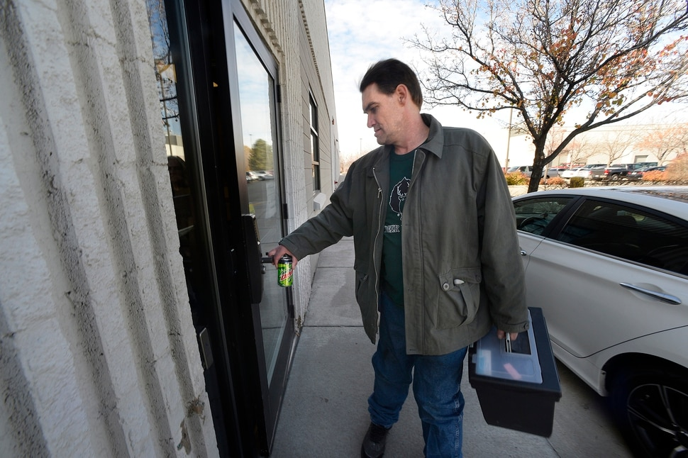 (Scott Sommerdorf | The Salt Lake Tribune) Joseph Hardy makes a stop at LDS Services in Welfare Square in Salt Lake City, Wednesday, November 8, 2017. He carries a bin that has all of his paperwork in case there is a need for a document while applying for services.