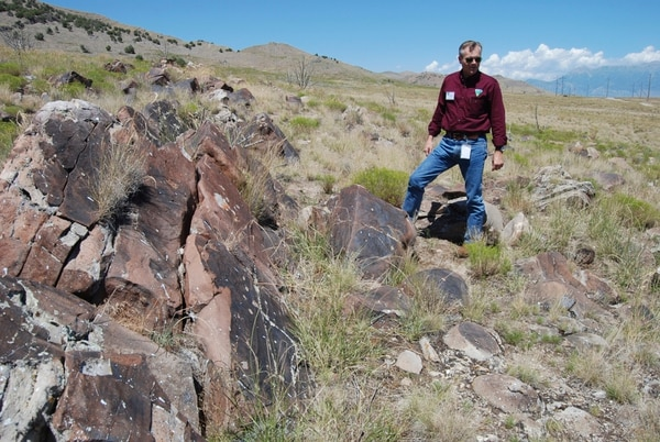 Brian Maffly | The Salt Lake Tribune Mike Sheehan, a BLM archaeologist, describes ancient petroglyphs at UtahÕs Lake Mountains that have been damaged by gunfire.