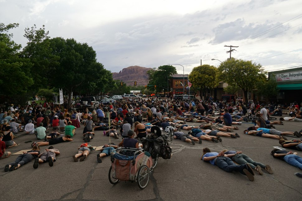 (Zak Podmore | The Salt Lake Tribune) Protesters lay down on Center Street in Moab for nearly nine minutes on Friday, June 5, 2020, to commemorate the killing of George Floyd by Minneapolis police officers in May.