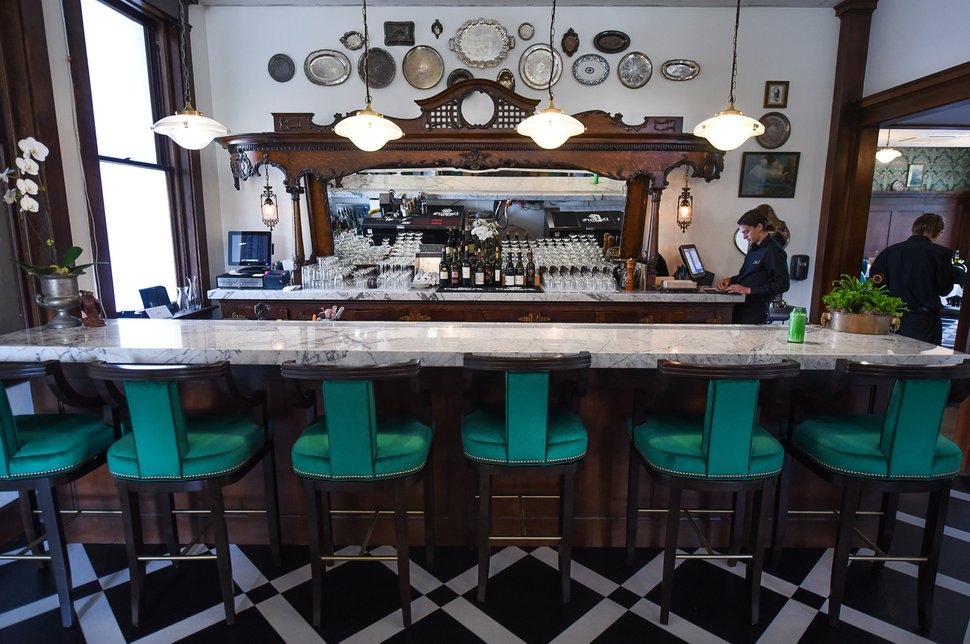 (Francisco Kjolseth | The Salt Lake Tribune) Caffe Molise recently opened in its new location inside the old (but completely updated) Eagle Building on the southwest corner of 400 South and West Temple. The wood frame and mirror in the bar were salvaged from the old Dead Goat Saloon, where owners Aimee Sterling and Fred Moesinger met.