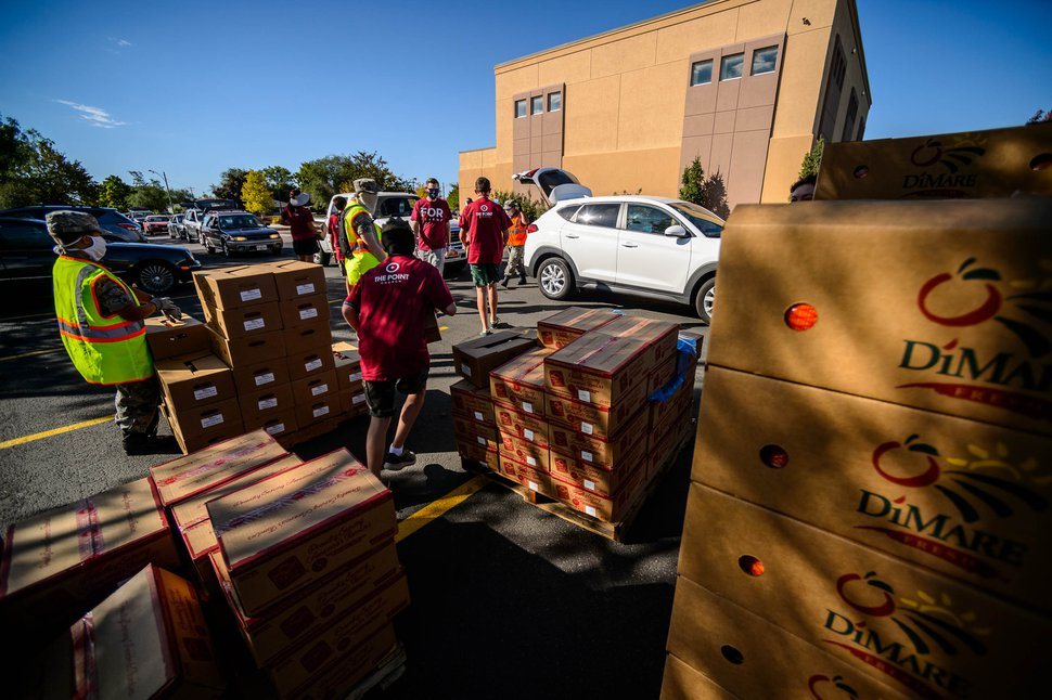 (Trent Nelson | The Salt Lake Tribune) Volunteers hand out food at The Point Church in Kearns on Saturday, Aug. 8, 2020.