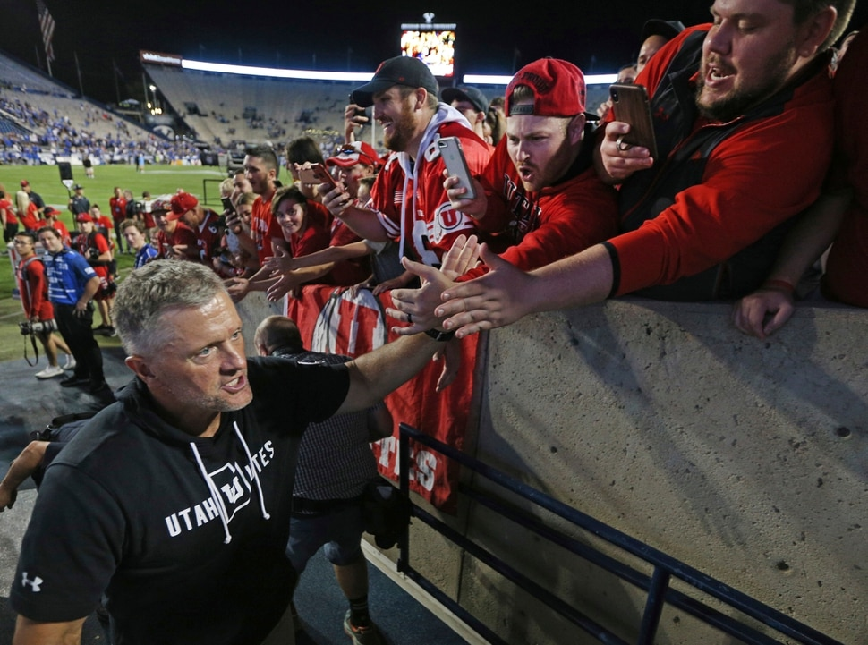 Utah head coach Kyle Whittingham greets fans after defeating BYU at an NCAA college football game, Thursday, Aug. 29, 2019, in Provo, Utah. Utah defeated BYU 30-12. (AP Photo/George Frey)