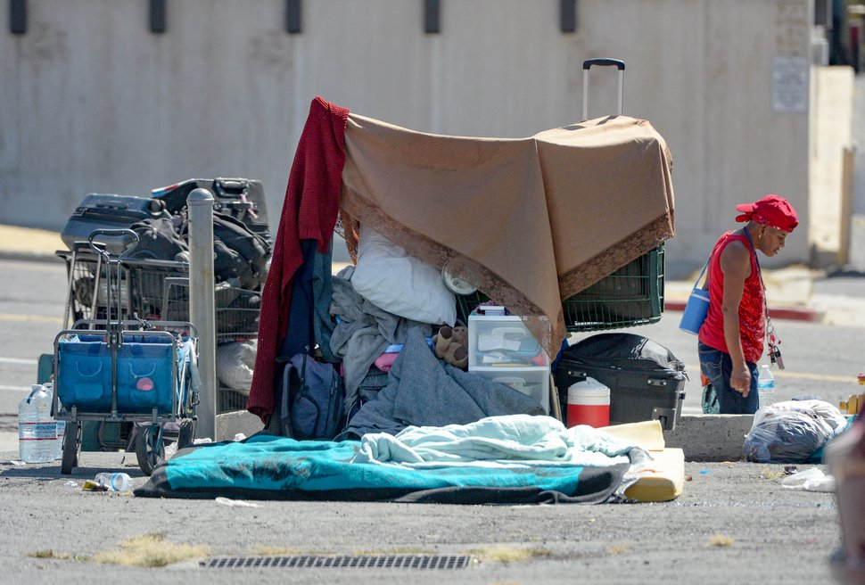 (Francisco Kjolseth | Tribune file photo) Homeless individuals camp out on the streets of downtown Salt Lake City, Aug. 12, 2020. As the coronavirus pandemic wears on, homeless service providers have seen a definite spike in the numbers of people seeking assistance and emergency shelter.