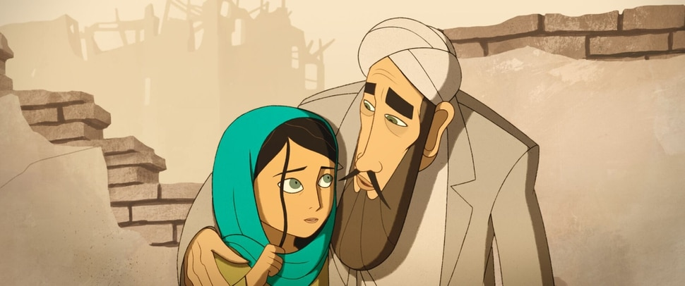 (photo courtesy GKids) Parwana (left, voiced by Saara Chaudry) shares a moment with her father, Nurullah (voiced by Ali Badshah), before he's arrested by the Taliban, in the animated drama