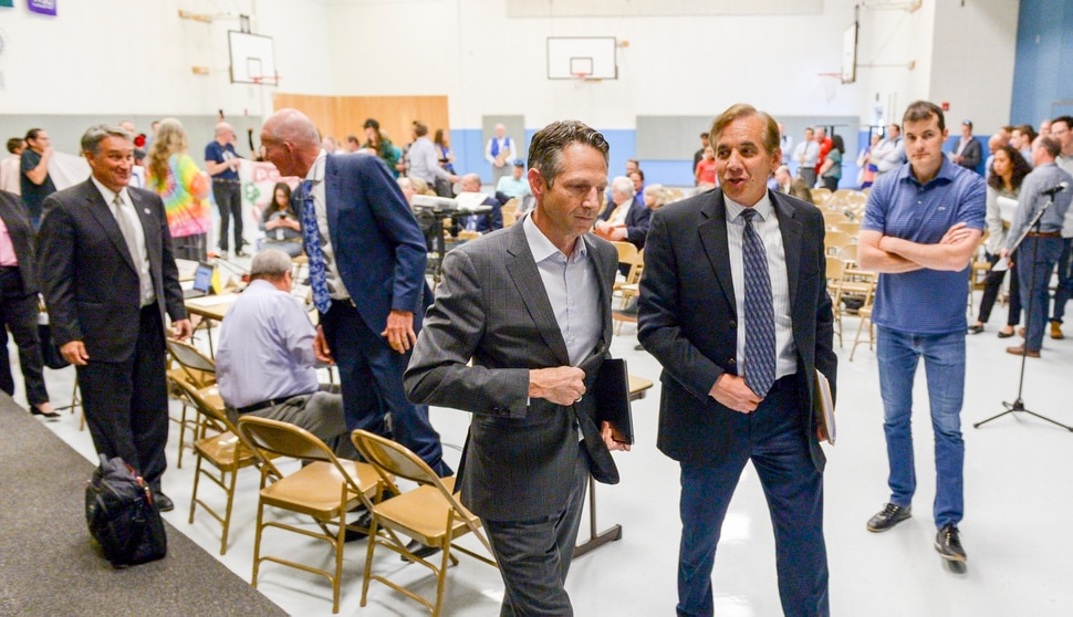 Leah Hogsten | The Salt Lake Tribune Derek Miller (center) leaves the meeting and canceled the meeting shortly after leaving the gymnasium. A group called Civil Riot shut down the Inland Port Authority Board meeting at North Star Elementary's gymnasium Wednesday, April 24, 2019 shortly after it began by speaking over board chairman Derek Miller.