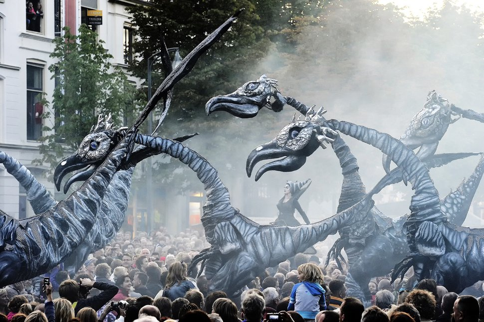 (Bert Holtmann | Courtesy of Close-Act Theatre ) Saurus, a street theater act from Amsterdam, will make its first Utah Arts Festival appearance, June 20-23, 2019. The interactive performance by Close-Act Theatre stars dinosaurs 16 feet long and 22 feet tall that will wander the grounds in the afternoons and evenings, with performances tentatively set at 4 p.m., 6 p.m. and 8 p.m.