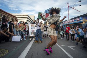 (Rick Egan  |  The Salt Lake Tribune) Protesters skate and dance in the streets of Salt Lake City during a march for racial equality on Sat., June 20, 2020.