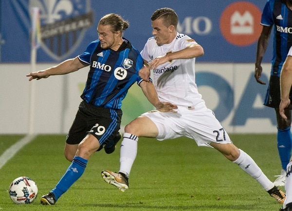 Montreal Impact's Samuel Piette, left, challenges Real Salt Lake's Brooks Lennon during the first half of an MLS soccer match in Montreal, Saturday, Aug. 19, 2017. (Graham Hughes/The Canadian Press via AP)