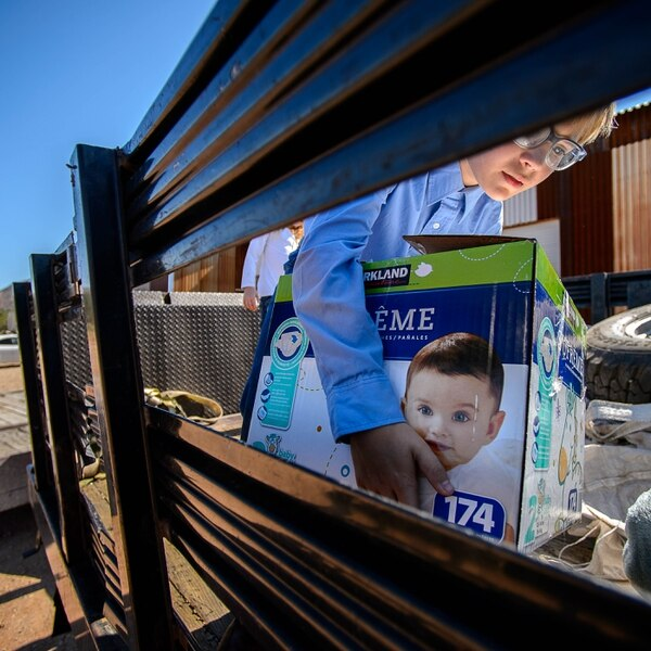 Trent Nelson | The Salt Lake Tribune 10-year-old Ammon Owen loads donations to deliver to needy members of the FLDS polygamous sect in Colorado City, Ariz., Saturday July 15, 2017. Owen and the Davis County Cooperative Society have been offering service and donations to needy FLDS members who were evicted from UEP homes in Hildale and Colorado City, Ariz.