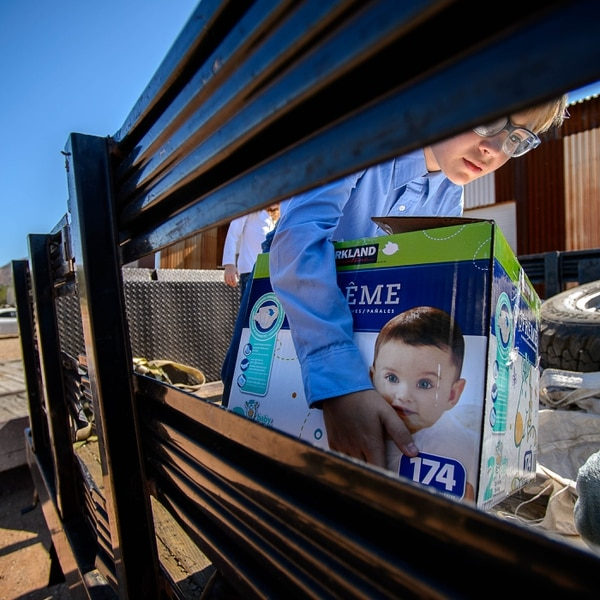 Trent Nelson   The Salt Lake Tribune 10-year-old Ammon Owen loads donations to deliver to needy members of the FLDS polygamous sect in Colorado City, Ariz., Saturday July 15, 2017. Owen and the Davis County Cooperative Society have been offering service and donations to needy FLDS members who were evicted from UEP homes in Hildale and Colorado City, Ariz.