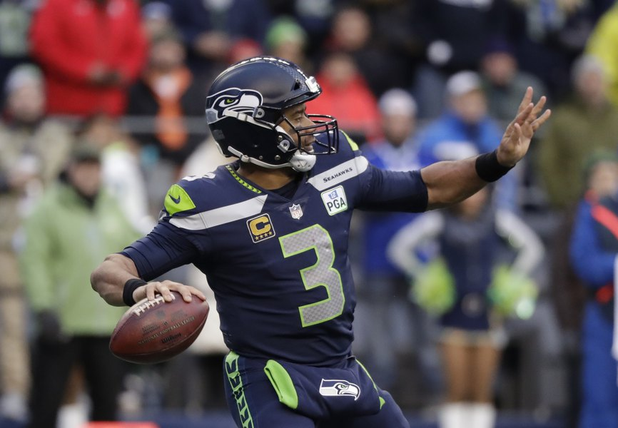Quarterback Russell Wilson Sticks With Seahawks Becomes