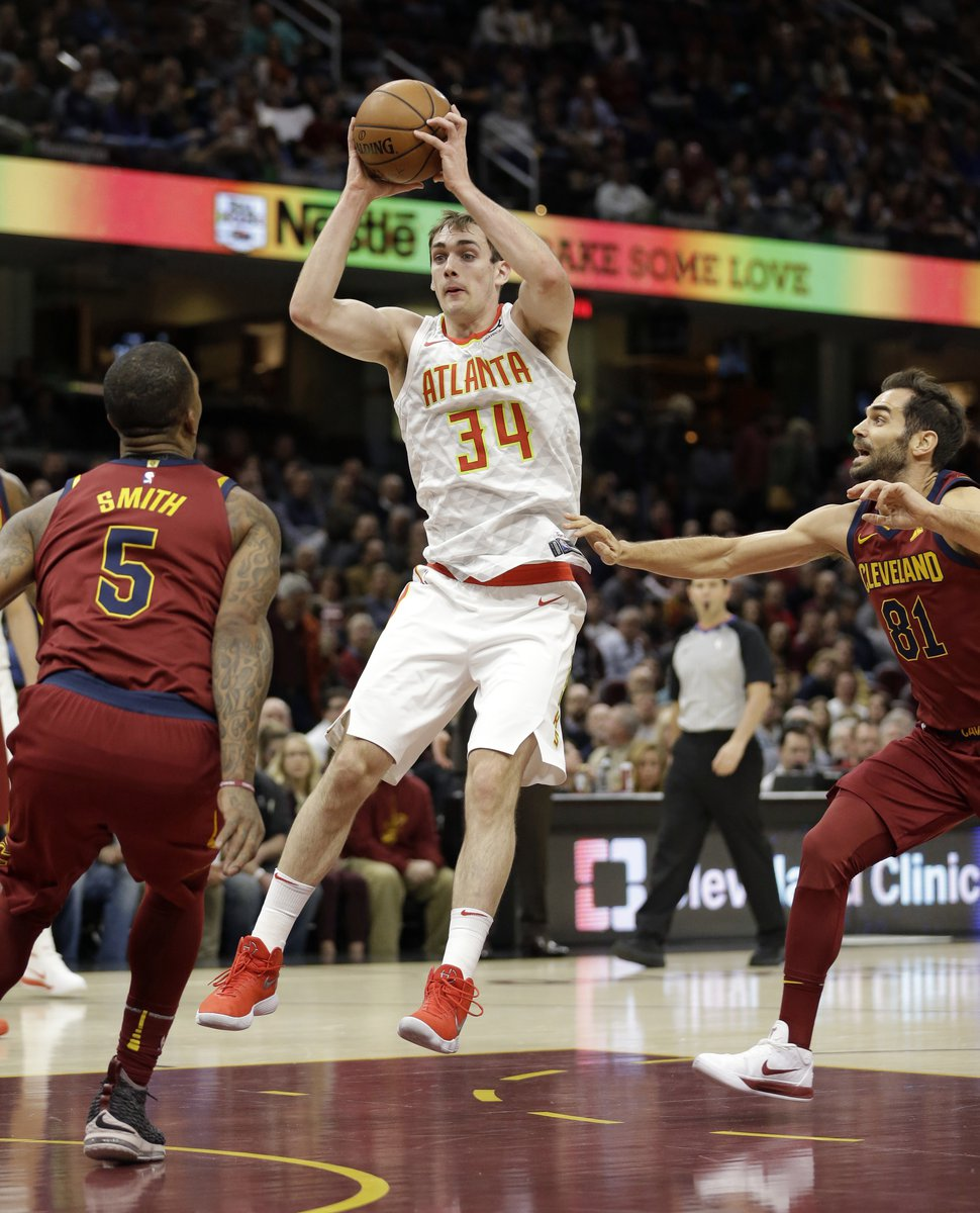 Atlanta Hawks' Tyler Cavanaugh (34) drives between Cleveland Cavaliers' JR Smith (5) and Cleveland Cavaliers' Jose Calderon (81), from Spain, in the first half of an NBA basketball game, Tuesday, Dec. 12, 2017, in Cleveland. (AP Photo/Tony Dejak)