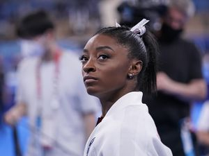 (Gregory Bull | AP) Simone Biles, of the United States, waits for her turn to perform during the artistic gymnastics women's final at the 2020 Summer Olympics, Tuesday, July 27, 2021, in Tokyo.