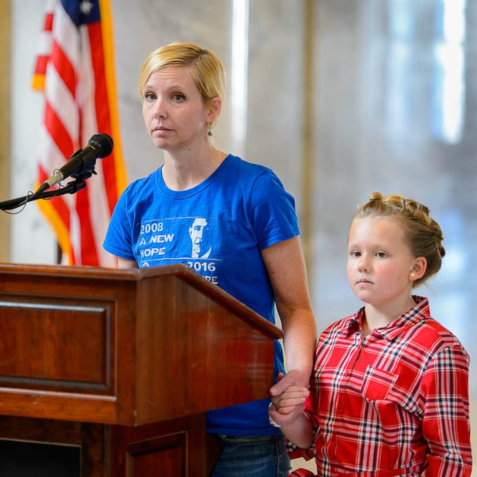 (Trent Nelson | The Salt Lake Tribune) Rebecca Richards Steed speaks with her daughter Aida at her side as graduate students rally at the Utah State Capitol against Republican proposals to eliminate the tax-free status for tuition waivers.