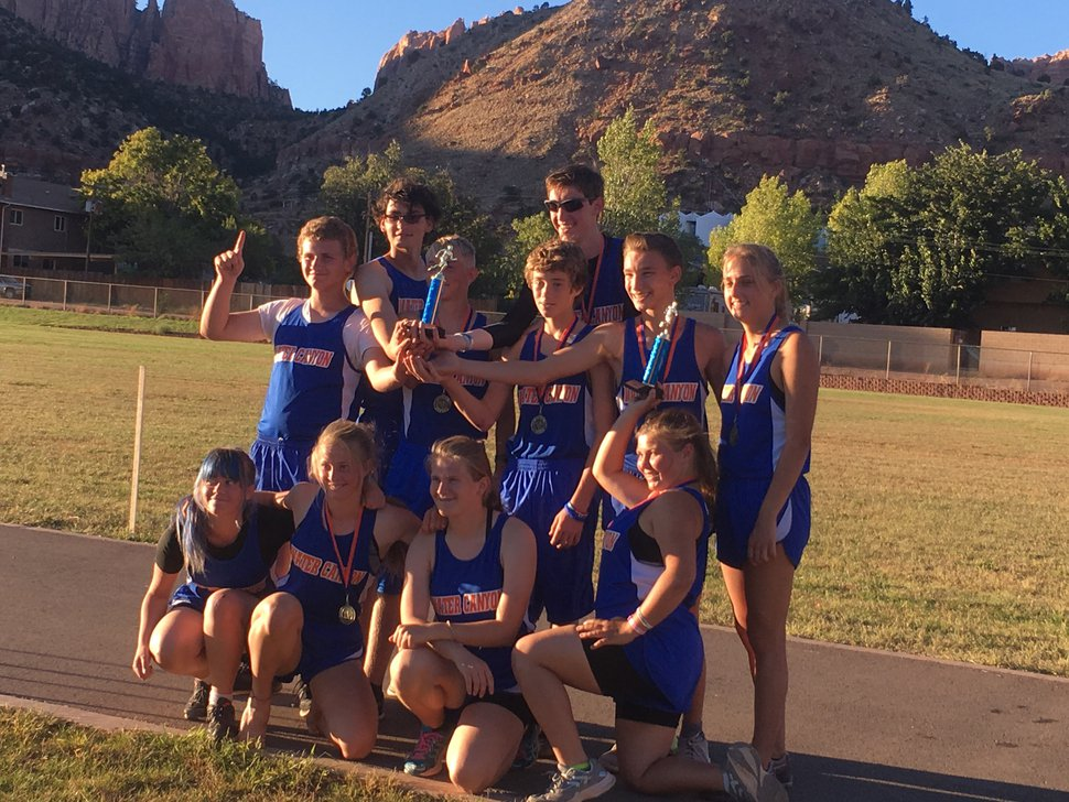 (Photo courtesy Dale Jeffs family) James Jeffs, back row center, poses with his Water Canyon High School cross country teammates Oct. 9, 2018, in Hildale, Utah. Jeffs, who is 6 feet 8 inches tall, and his teammates have qualified for Utah's state cross country meet.