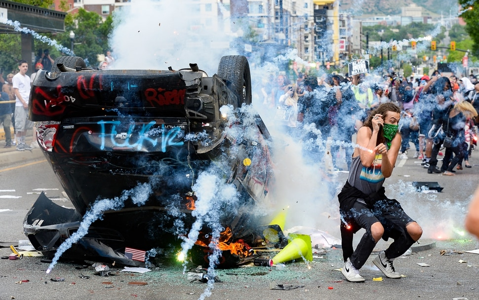 (Francisco Kjolseth | The Salt Lake Tribune) Hundreds march in downtown Salt Lake City overturning a police car and setting it on fire on Saturday, May 30, 2020, to protest the death of George Floyd, the man who died earlier this week after a Minneapolis police officer knelt on his neck.