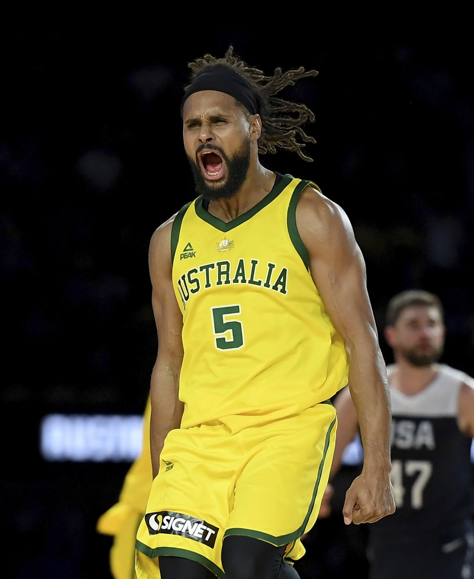 (Andy Brownbill | AP) Australia's Patty Mills celebrates after shooting a 3-pointer during their exhibition basketball game against the U.S in Melbourne, Saturday, Aug. 24, 2019.