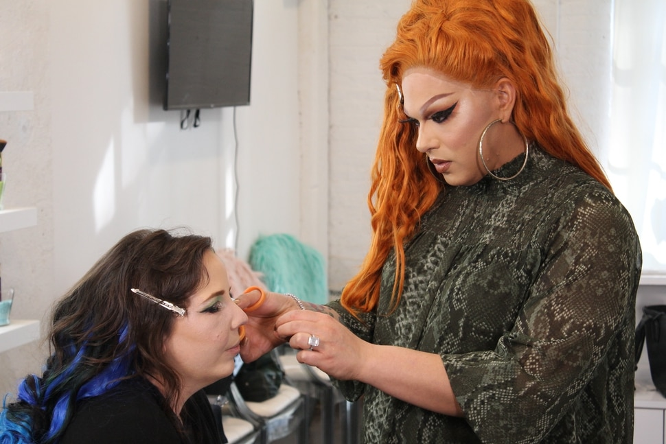 "(Photo courtesy of TLC) Alexis Michelle applies makeup on ""Dragnificent."""