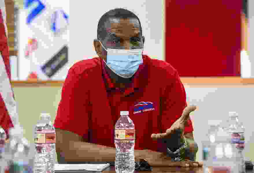 Burgess Owens appears on a QAnon conspiracy theory-linked program