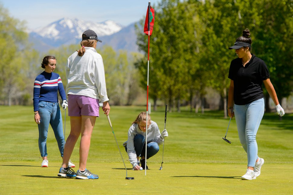 (Trent Nelson | The Salt Lake Tribune) Hunter High School's Cierrah Peterson, Lily Brock, Peyton Newell, and Charity Ralphs at Meadowbrook Golf Course in Taylorsville on Friday May 3, 2019.