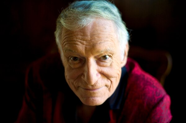(Kristian Dowling | The Associated Press) This Oct. 13, 2011 file photo shows American magazine publisher, founder and Chief Creative Officer of Playboy Enterprises, Hugh Hefner at his home at the Playboy Mansion in Beverly Hills, Calif. Playboy magazine founder and sexual revolution symbol Hefner has died at age 91. The magazine released a statement saying Hefner died at his home of natural causes on Wednesday night, Sept. 27, 2017, surrounded by family.