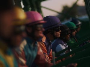"(Adolpho Veloso  |  courtesy of Sundance Institute) Clifton Collins Jr. (center, in the purple silks) stars as an aging jockey in ""Jockey,"" by Clint Bentley. It's an official selection of the U.S. Dramatic Competition at the 2021 Sundance Film Festival."