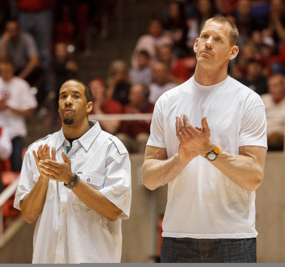 Trent Nelson | The Salt Lake Tribune Former Utah players Andre Miller and Michael Doleac applaud as former Utah coach Rick Majerus' sweater is retired. Utah hosts Colorado, college basketball Saturday, February 2, 2013 in Salt Lake City.