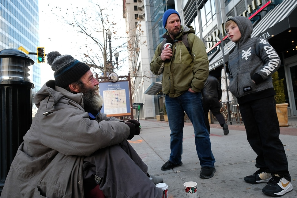 (Francisco Kjolseth | The Salt Lake Tribune) Ten-year-old Chase Hansen and his father John who have an organization called Project Empathy, meet Chris Coons in downtown Salt Lake City on Monday, Dec. 16, 2019, as Chase interviews Coons about his life. The two of them spend time with people experiencing homelessness in an effort to connect with people on a personal level. On this occasion Chase learns that Coons used to be an electrician before losing much of his vision and how he loved to ski.